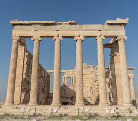 Full view of one side of the ancient Erechtheion Temple, with ionic columns.
