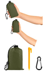 Very compact hand held green nylon pocket blanket in a drawstring bag, with plastic tent stakes and carabiner. Thin tarp for outdoor activities. Isolated on white background, clipping path included.