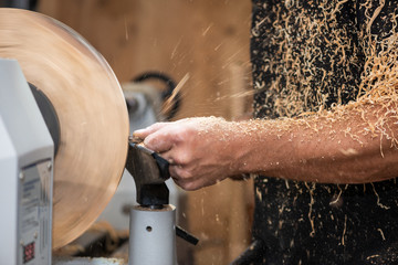 sawdust shavings of wood turnery while making a handcrafted bowl