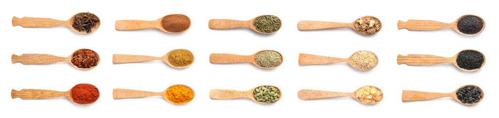 Wooden spoons with different spices and herbs on white background. Large collection