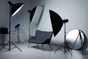 Modern photo studio with professional lighting equipment