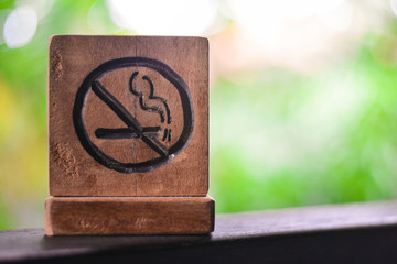 No smoking sign or non smoking area with green nature background. stop smoking and prohibition concept. Wall mural