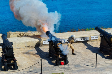 Gunfire at noon in Saluting Battery at Fort Lascaris, view from from Upper Barrakka Gardens, Valletta, European island state of Malta