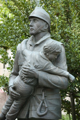 old funeral statues of fireman