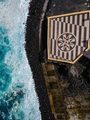 """Aerial view of a look-out point  with a rose of the winds in Portuguese sidewalk. Island of São Miguel. """"Ribeira Grande"""" in Portugal. Drone Shot"""