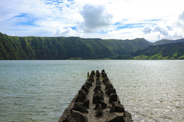 beautiful lagoon surrounded by mountains with a Jetty. Ancient volcano crater. Seven Cities lagoon Azores Islands Portugal