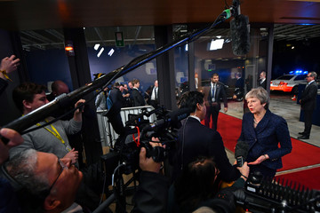British Prime Minister Theresa May talks to reporters as she arrives at the European Council to meet with European Council President Donald Tusk to discuss draft agreements on Brexit, in Brussels