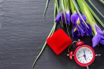 exquisite purple iris flower on natural stone background, engagement concept