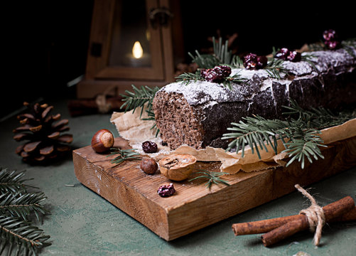 Chocolate swiss roll cake roulade with nuts