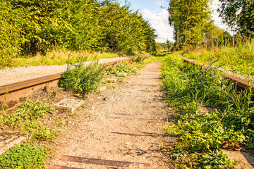 old closed overgrown railway
