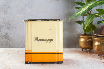 Old vintage yellow orange tin box