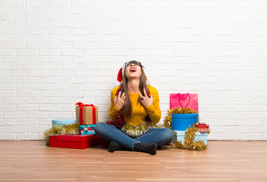 Girl celebrating the christmas holidays annoyed angry in furious gesture