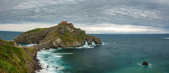 San Juan de Gaztelugatxe long exposure wide panorama with clouds