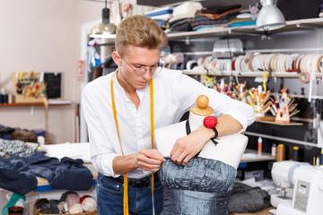 Dressmaker using tape measure