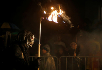 A man dressed as a demon performs during a Krampus show in Goricane