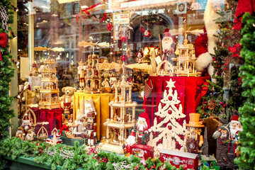 Different colorful Christmas toys in the shop. (Wooden toys, stars, cones). New year. Christmas background.