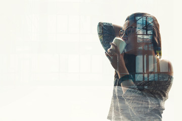 Double exposure of a businesswoman with business district building
