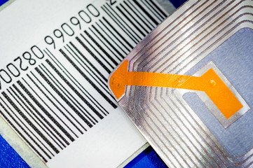 Close up of RFID tags ana a code bar used for tracking and identification purposes and as an anti-theft system in commerce and retail.