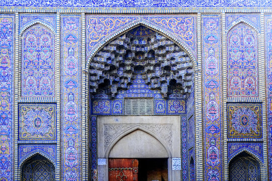 Exterior of Nasir al-Mulk Mosque facade. Persian text at the right door means visiting-hours  of the mosque as English text at the left door. Shiraz, Iran.