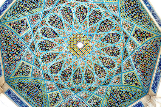 Tilework on the ceiling of the Tomb of Hafez pavilion. Shiraz, Iran.