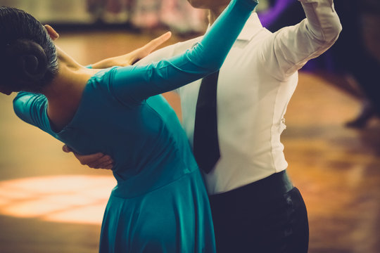 Motion blur of couple dancers dance on the floor