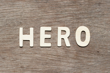 Alphabet letter in word hero on wood background