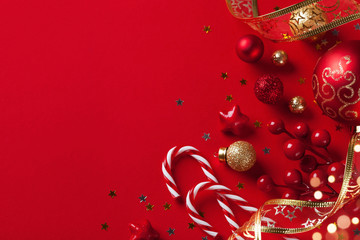 Christmas card or banner. Christmas decorations on red background.
