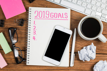 2019 new year goal,plan,action text on notepad with office accessories.Business motivation,inspiration concepts