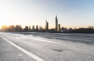 Tuinposter Dubai Panoramic skyline and modern buildings with empty road