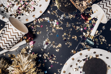 Top view marble table with party cup,party blower,tinsel,confetti.Fun Celebrate holiday party time table top view.Festive greeting card.