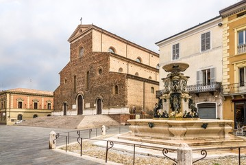View at the Cathedral of Saint Peter the Apostle and fountain at the Liberty place in Faenza - Italy