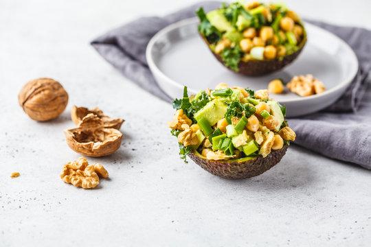 Avocado halves stuffed with avocado, nuts and chickpeas.