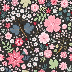 Beautiful seamless ditsy pattern with pink flowers on black background. Fashion design. Vector illustration.