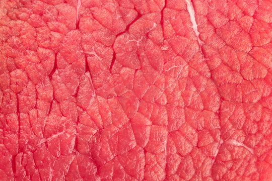 An overhead photo of meat texture, raw cut, also called eye round beef