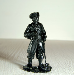 Pirate figurine with a saber molded plastic close up Selective Focus