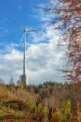 Windturbine in autumn, one of the 4 tallest windgenerators in the world near Gaildorf in Germany with combined pump storage plant