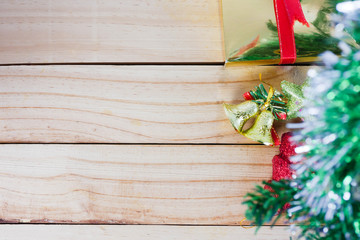 Christmas tree and golden bells with star on the wooden background