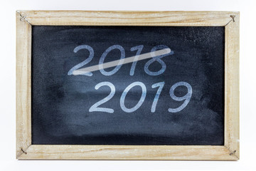 small school blackboard with the numbers 2018 and 2019 - new year