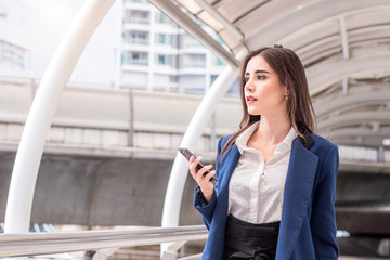Business woman with smartphone at business district