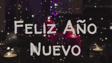 Greeting card Feliz Ano Nuevo, Happy New Year in spanish language, falling snow, candles and gifts