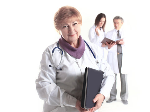 female doctor therapist with laptop on blurred background of colleagues