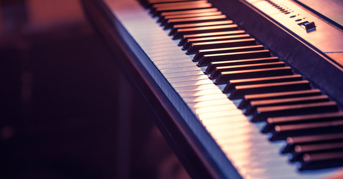 piano keys close-up, on a beautiful colored background