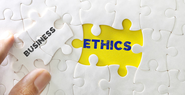 Close up piece of white jigsaw puzzle with word of Business Ethics , concept of business core value and moral