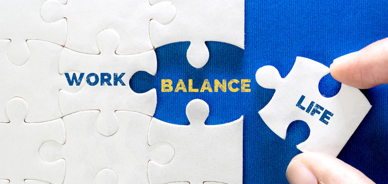 Close up piece of white jigsaw puzzle with word of WORK LIFE BALANCE , a concept of wellbeing and balanced lifestyle