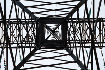 Metal frame of an electrical tower in cloudy weather