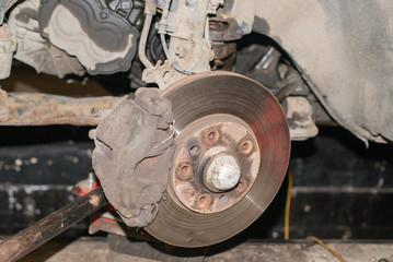 Car repair, brake disc repair. Car's disc brake detail.