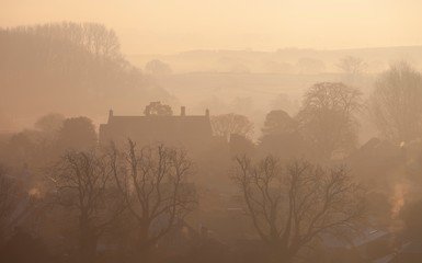 Misty sunrise at Chipping Campden, Cotswolds, Gloucestershire, England