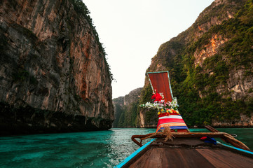 Old wooden boat on Asian Islands. Asian Islands. Thai Phi Phi Islands. Thai wooden boat. Boat in the Bay. Travelling to Asia. Travel to Thailand. Lagoon on the island. Boating around the island