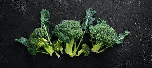 Broccoli. Fresh green broccoli on a black stone table. Top view. Free copy space.