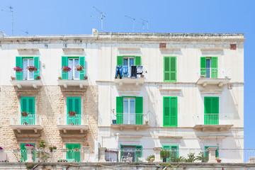 Molfetta, Apulia - Green window shutters at the historical facades in Molfetta